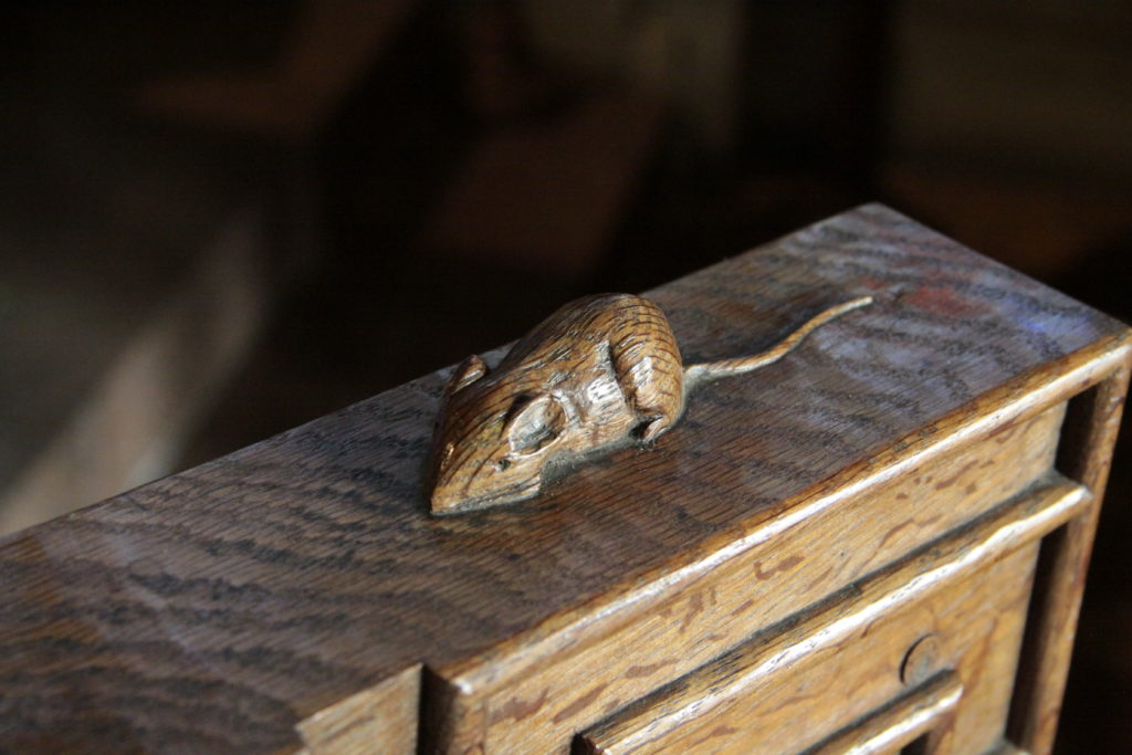 A carved mouse, the signature of famous carpenter Robert Thompson